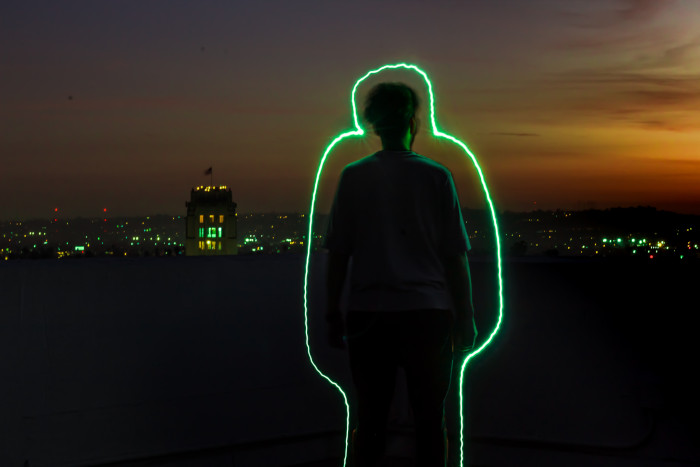 man with a neon green outline