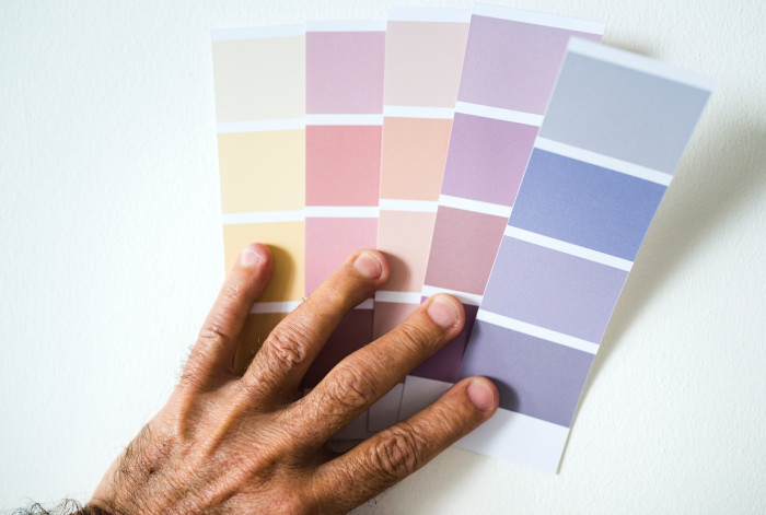 person holding different colour schemes
