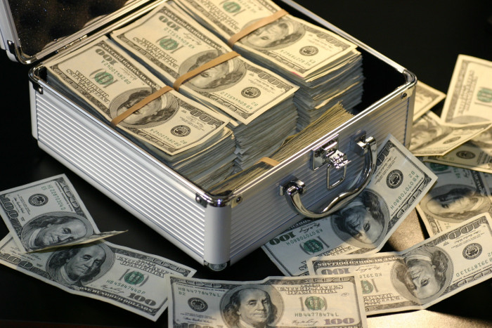 silver suitcase filled with money