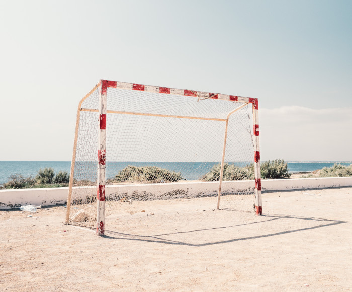 soccer net on a beach