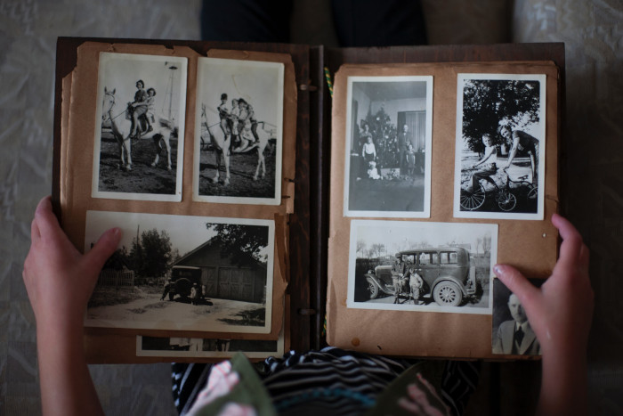 someone holding an old photo album