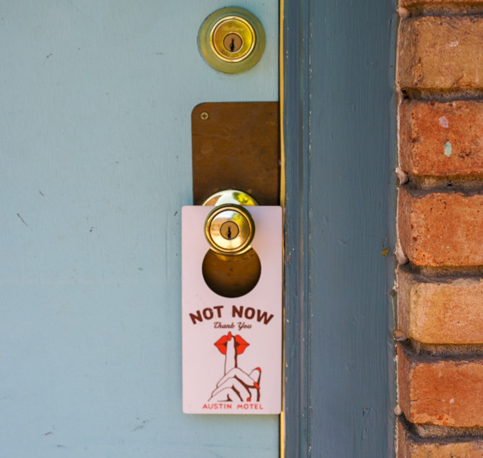 Not now sign on the door knob of an hotel door
