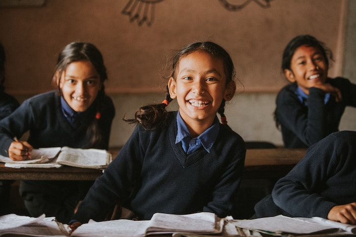Happy students in classroom