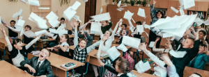 students throw paper