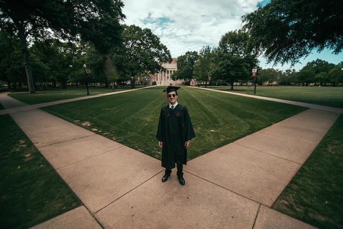 Graduate standing on pathway