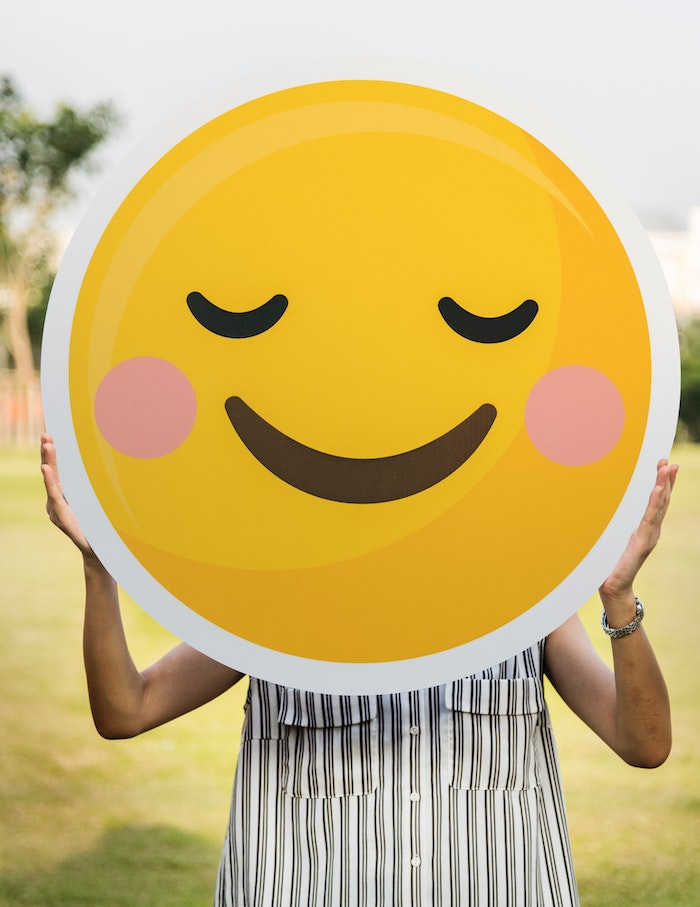 Person holding big smiley