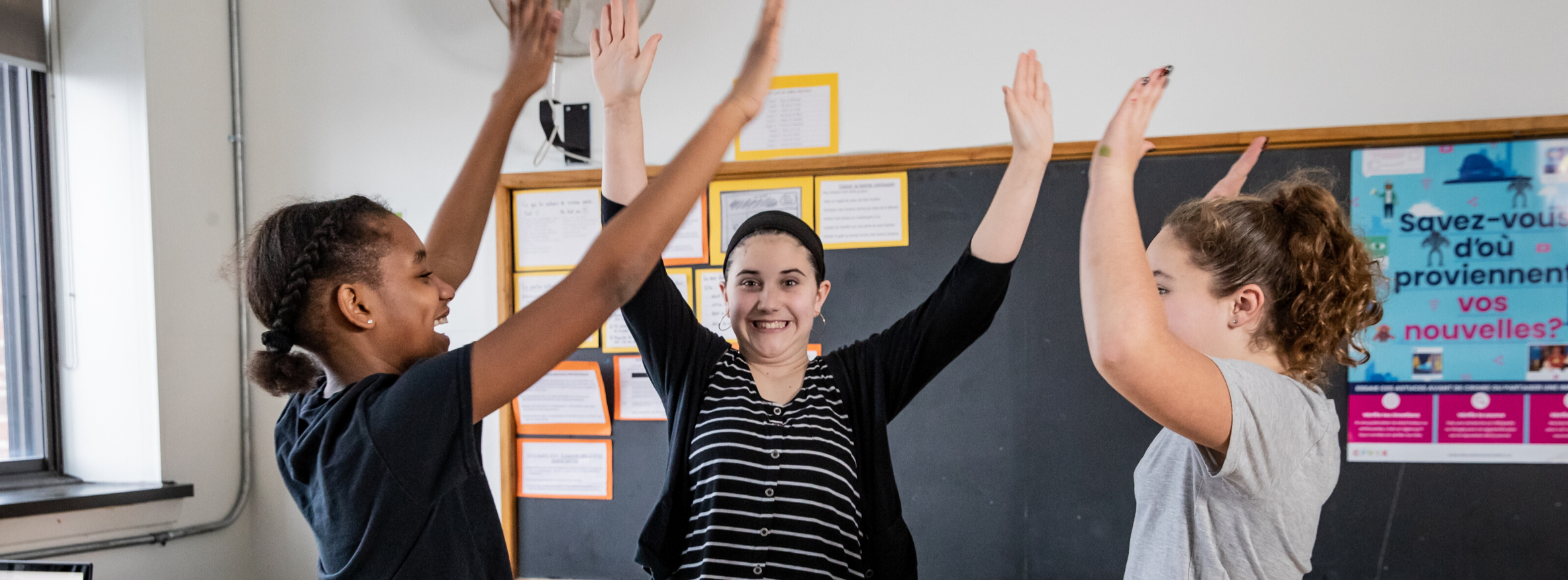 Students high-fiving in the classroom