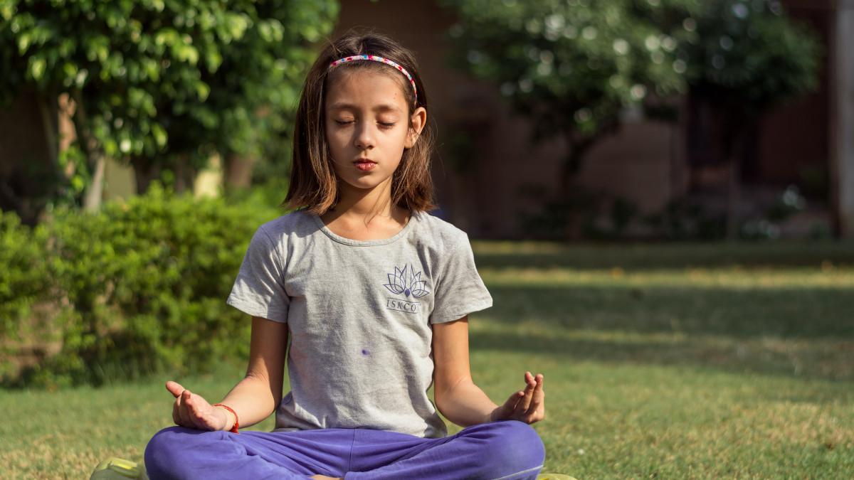 Girl meditating outside