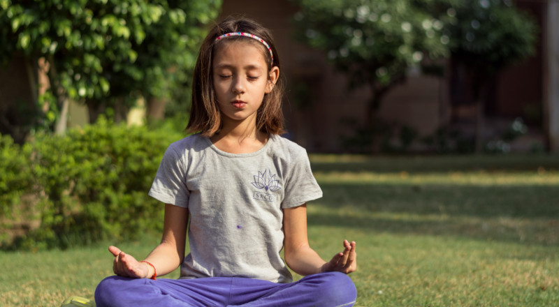 girl meditating outside