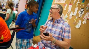 Student and teacher laughing [Google Edu]