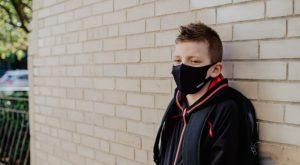 Child wearing a mask outside