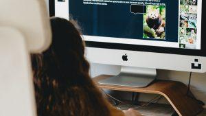 Girl doing her homework on the family computer