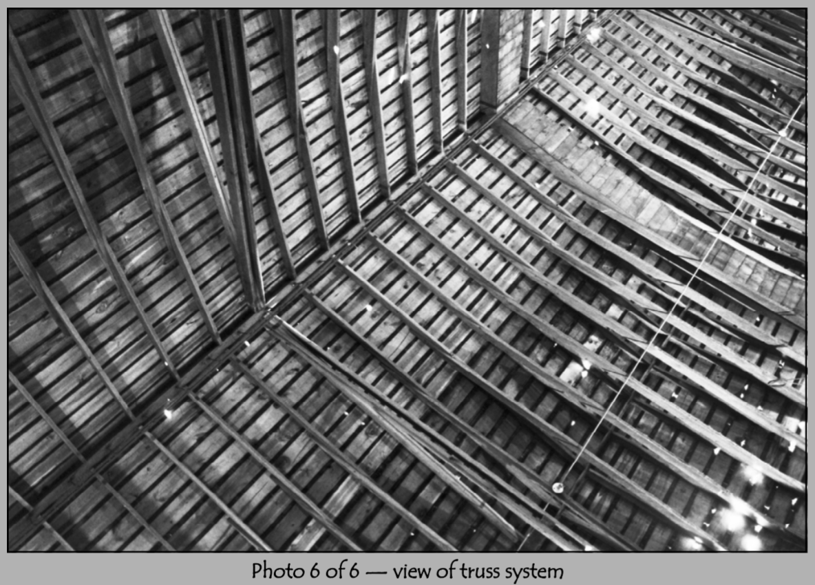 The Ackerhurst Barn's truss system in 2001.  Trusses are beams that support roof.  These trusses are made of wood, but most modern structures use metal.