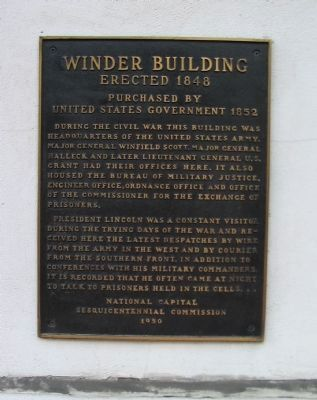 A 2008 photo of the initial historical marker plaque on the side of the Winder Building. The plaque mistakenly claims that President Lincoln used to visit the building to speak with Confederate prisoners. New research shows the building never housed prisoners.