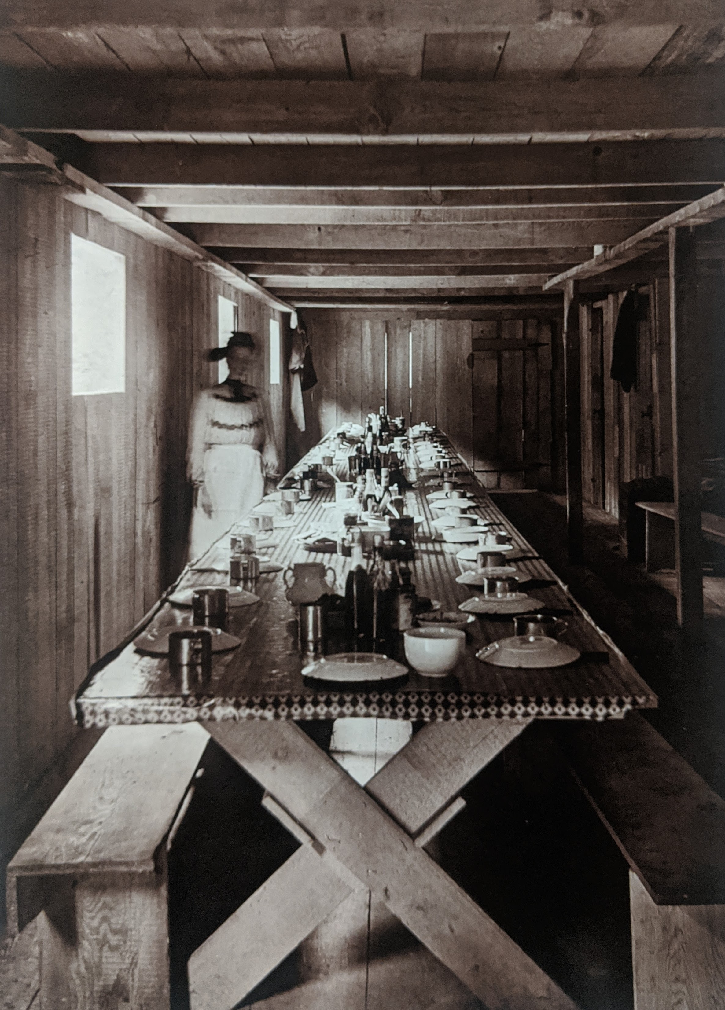 Photo taken by William T. Clarke. The interior of a dining room set up for dinner.