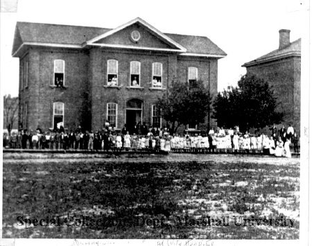 Students gathered outside the original Buffington School
