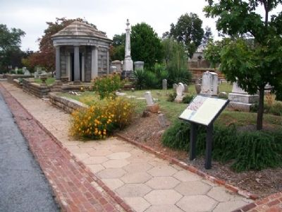 Wide shot of the Slave Square Historical Marker in Oakland Cemetery.