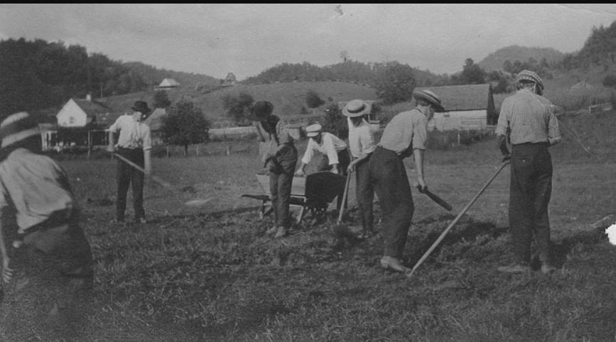 Students clearing the athletic field in 1925.