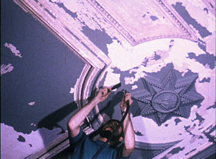 Volunteers work to restore the damaged ceiling of the interior of Iolani Palace
