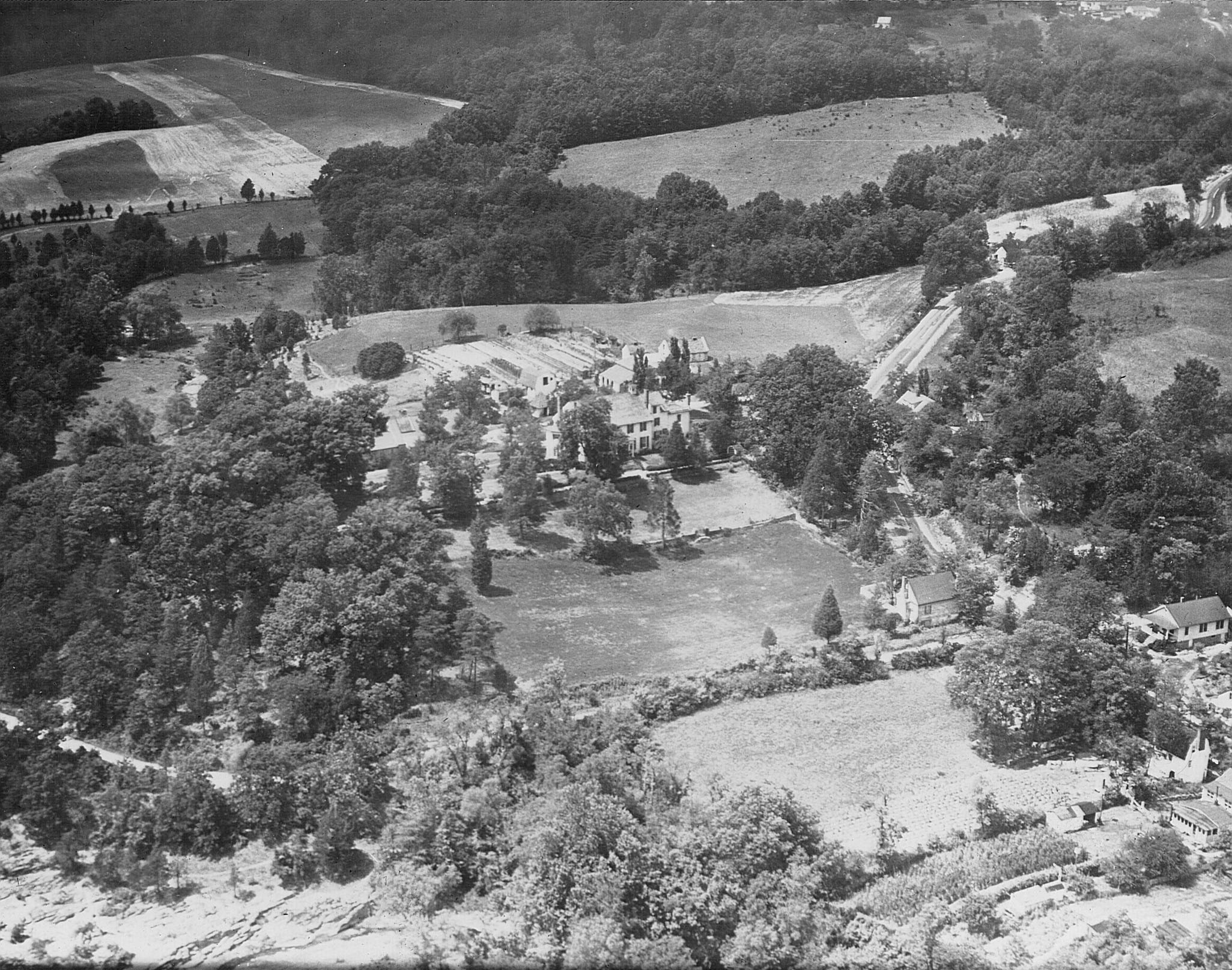 1940s aerial view showing vegetable gardens and orchard behind the garage