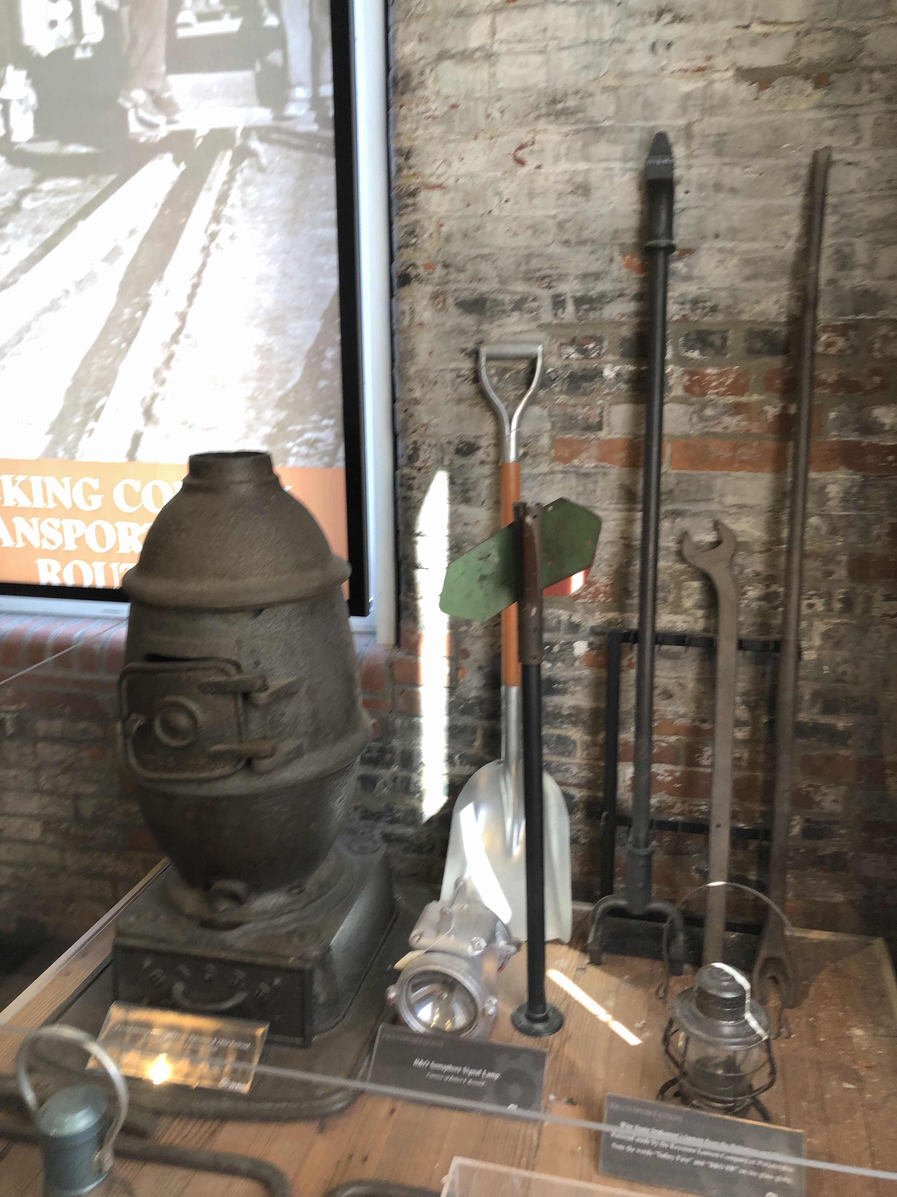 Several tools used by the B&O, including a wood burning stove, tools for repairing rails, and a brakeman's lantern.