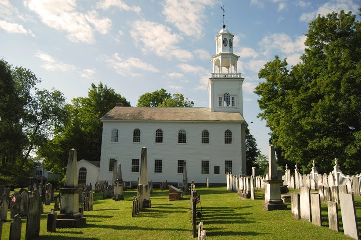 Side view of the church with cemetery in the foreground that contains the graves of Revolutionary War soldiers and Robert Frost.