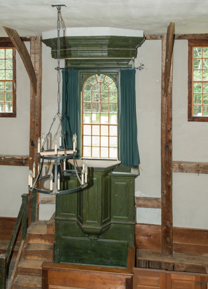 A close up of the raised green pulpit that raises its speaker to nearly the same level as the gallery.