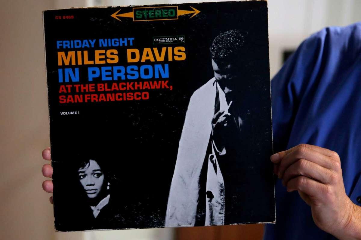 Director of Uptown Tenderloin, Randy Shaw holding up an original copy of a live Miles Davis album recorded at The Black Hawk, a Tenderloin jazz club