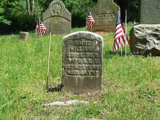 The tombstone of Corporal Amos Williams, who served in the Civil War.