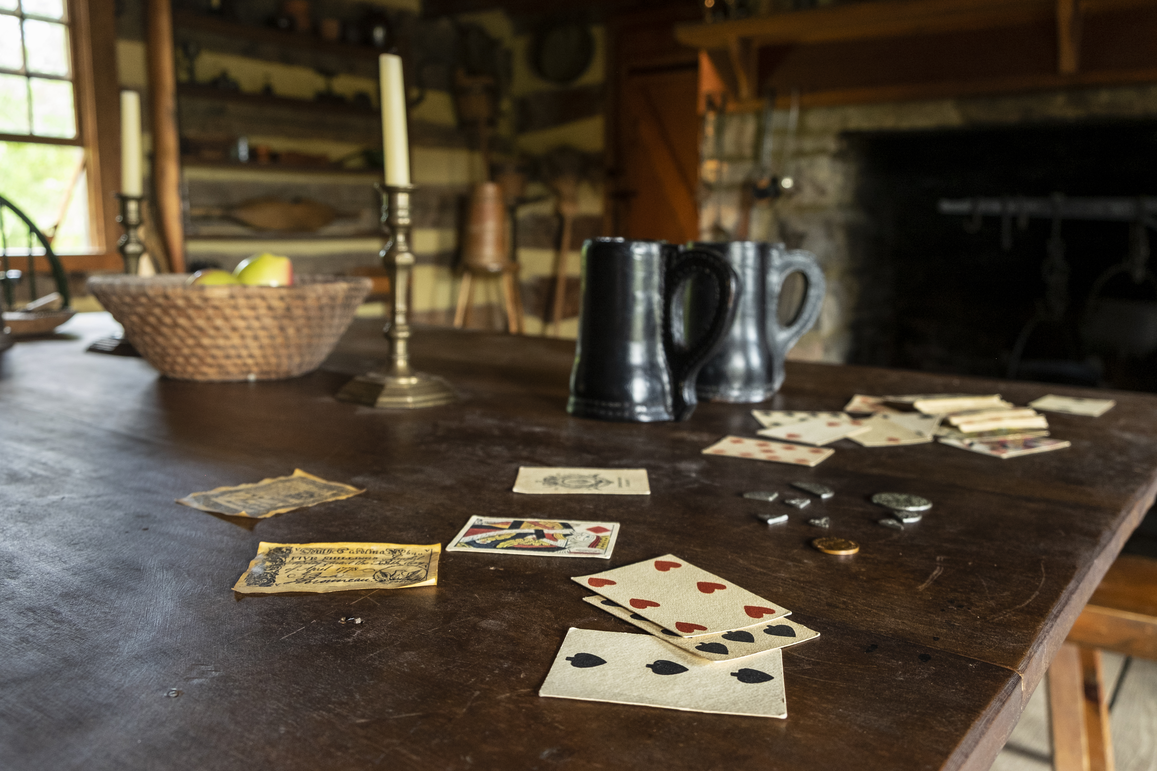 A game of cards on the tavern table