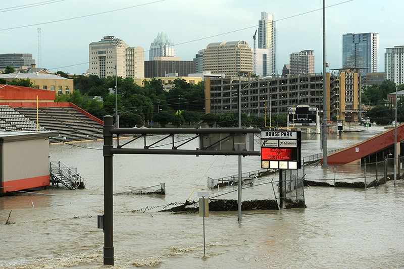 The destruction of the Memorial Day Floods of 2015, an entire  football stadium is engulfed by flood water.