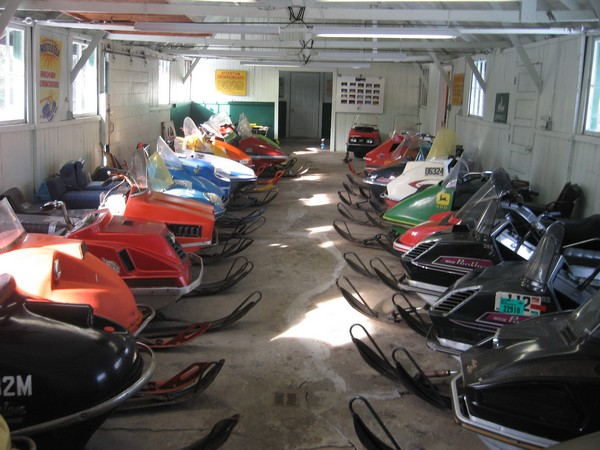 Vintage snowmobiles on display in the New Hampshire Snowmobile Museum.