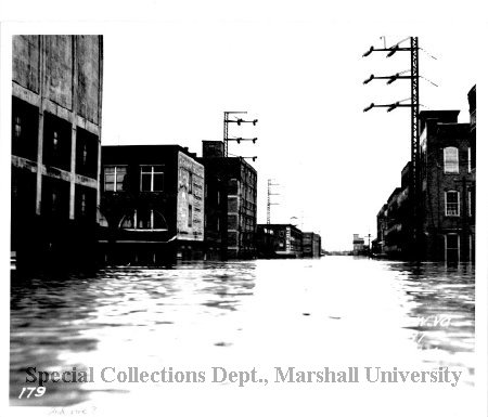 Looking down Second Avenue, with Gwinn Bros. Mill on the left, during the flood of 1937