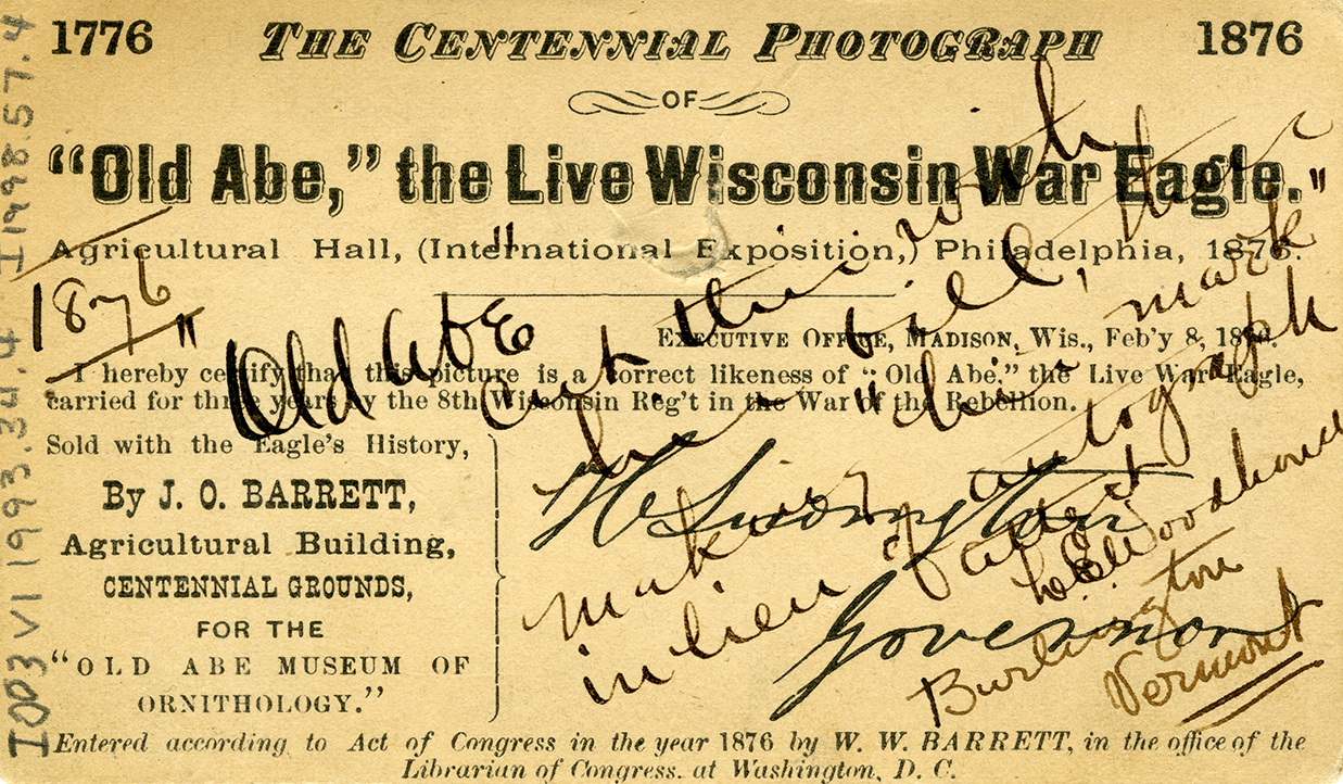 """""""'Old Abe' the Live Wisconsin War Eagle, Agricultural Hall (International Exposition), Philadelphia, 1876."""" Writing over the printed text notes the cut in the image made by Old Abe's bill, a mark made in lieu of an autograph."""