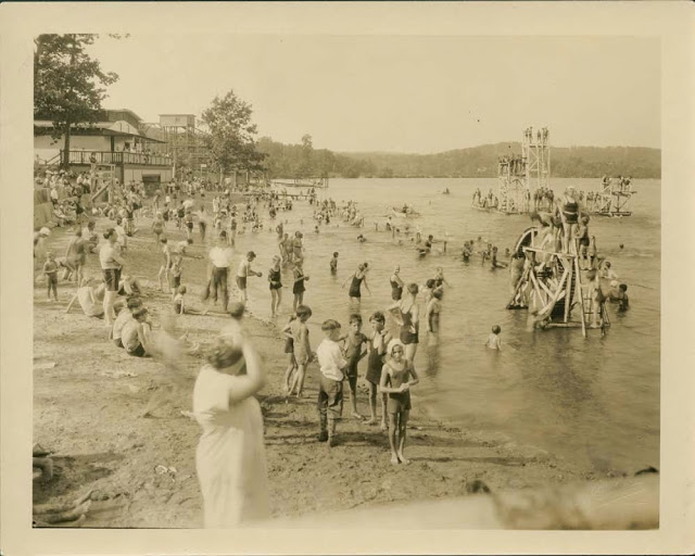 The beach part of the lake with water attractions for the family, 1930s Collection of City of Waterbury, Silas Bronson Library Digital Photos.
