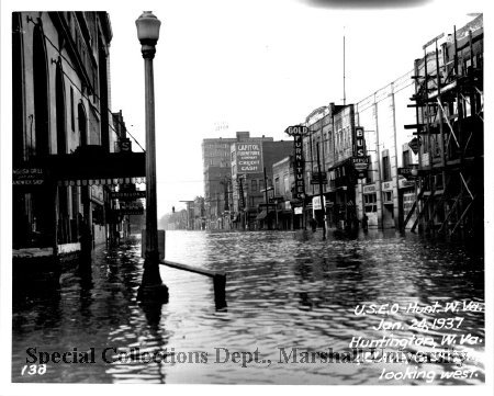 The bus depot is visible at right in this shot from the 1937 flood
