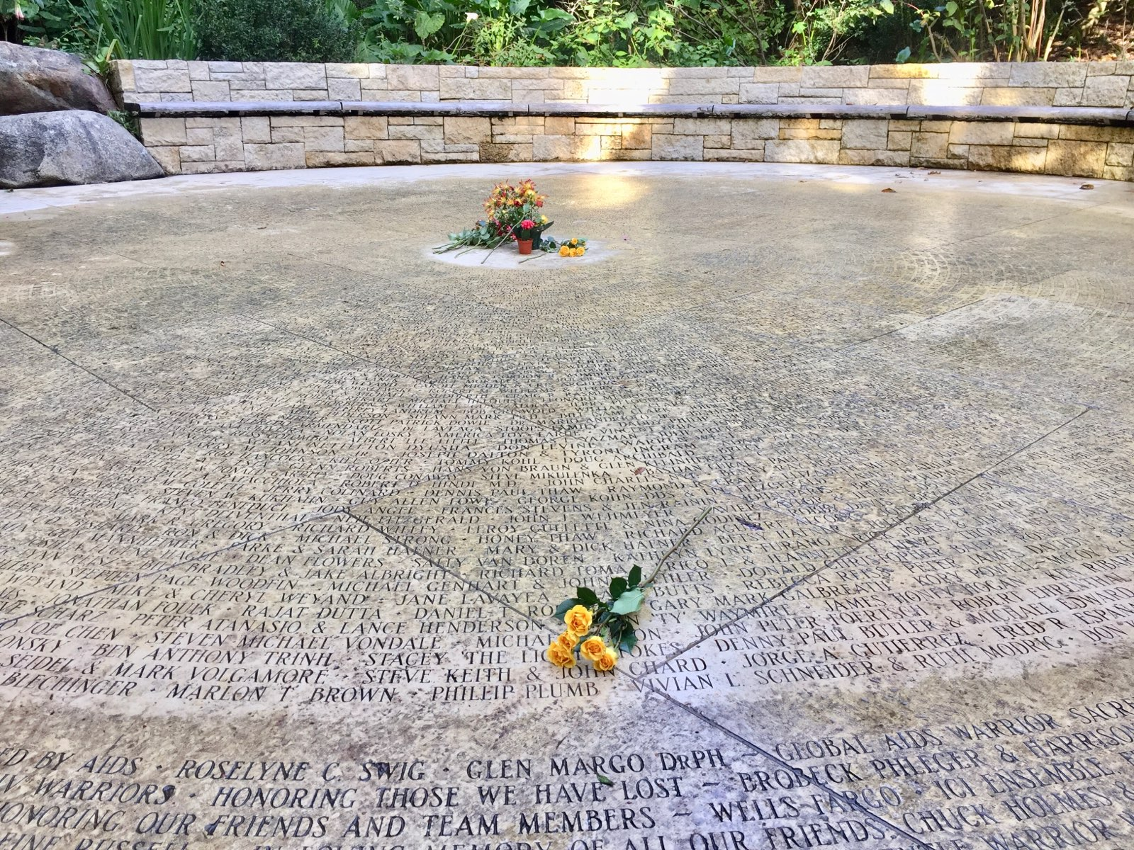 """""""Circle of Friends"""" marker, inscribed with names of those who died from AIDS, along with the names of friends, family, and supporters"""