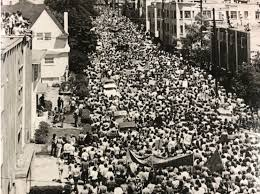 """Protestors march in downtown Berkeley after law enforcement and National Guard is called in to occupy the newly created """"People's Park"""" and """"People's Park Annex"""" (May 30, 1969)"""