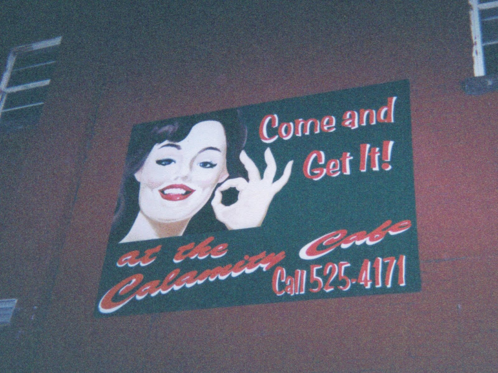 A sign inside Calamity Cafe