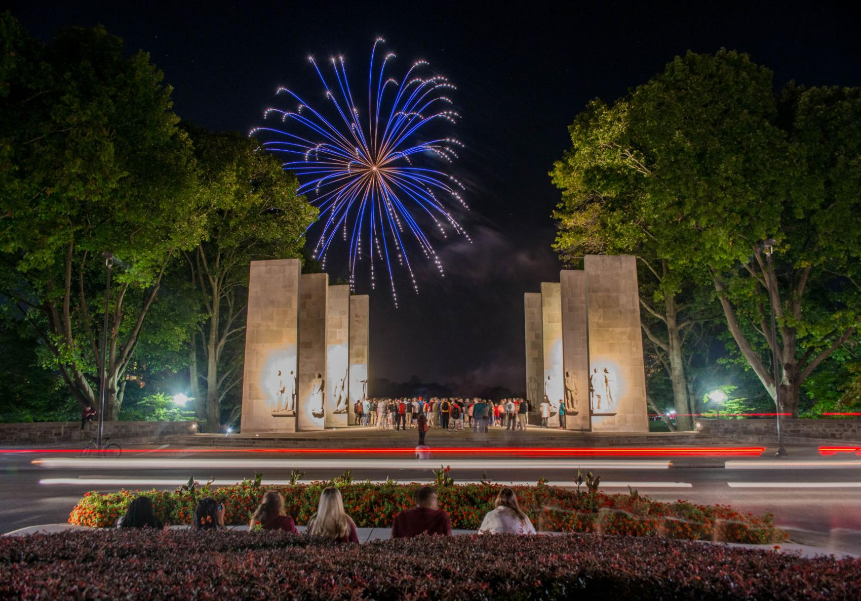 This image represents the Ring Reveal firework show as it is seen from spectators at the Chapel.