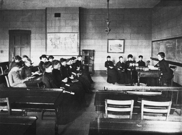 Image of a classroom at the school, circa late 1800s.