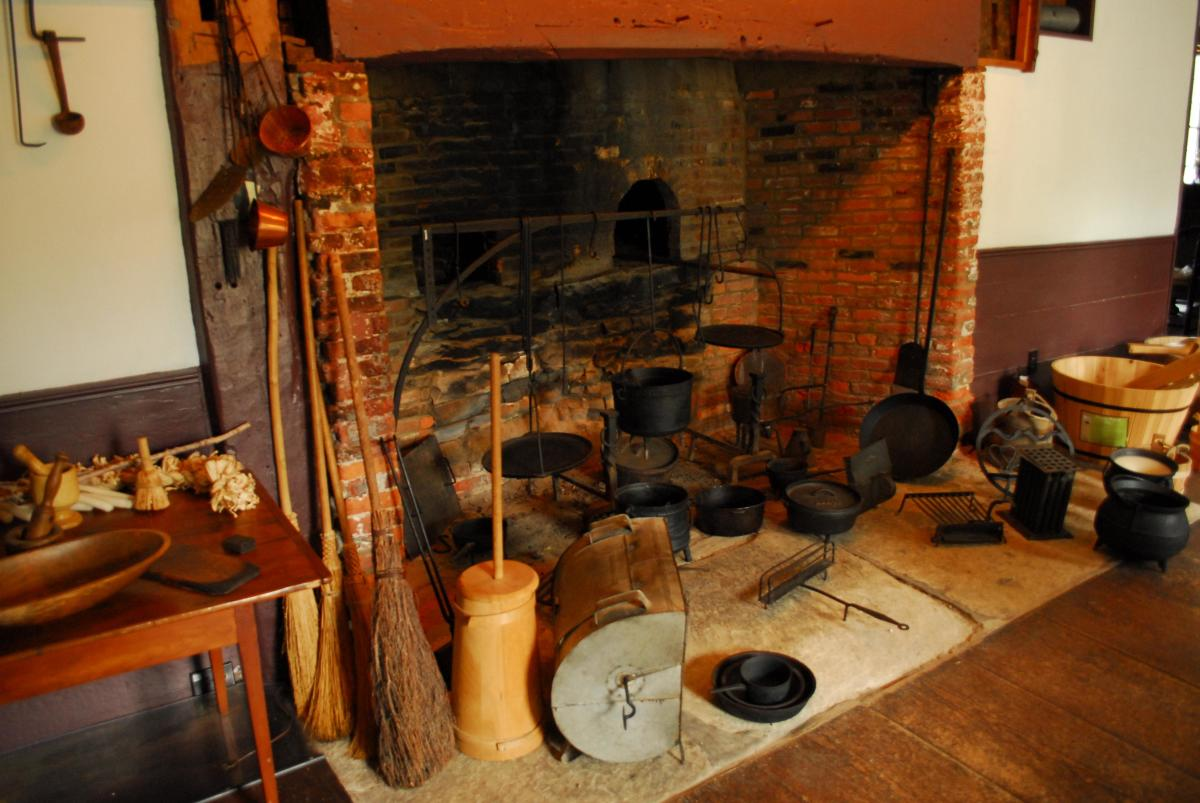 A close-up of the large fireplace in the castle's kitchen.