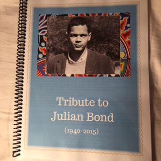 The photo memorial book created that contains photos of people honoring Julian Bond's life.