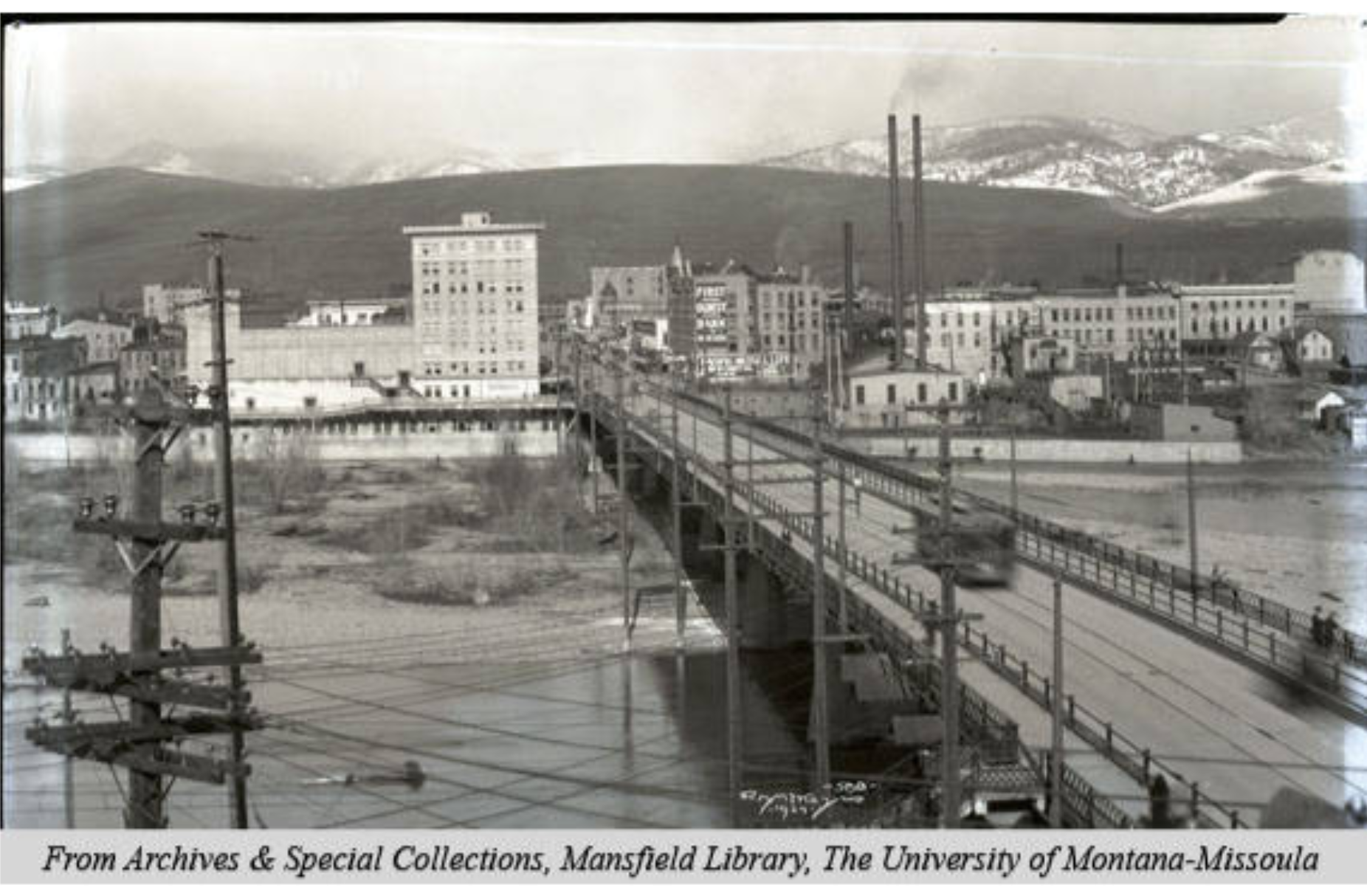 A speeding streetcar crosses the Higgins Avenue Bridge, circa 1924