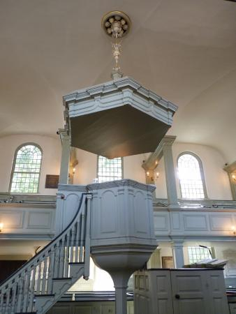 A side view of Trinity's unique, chalice-shaped pulpit.