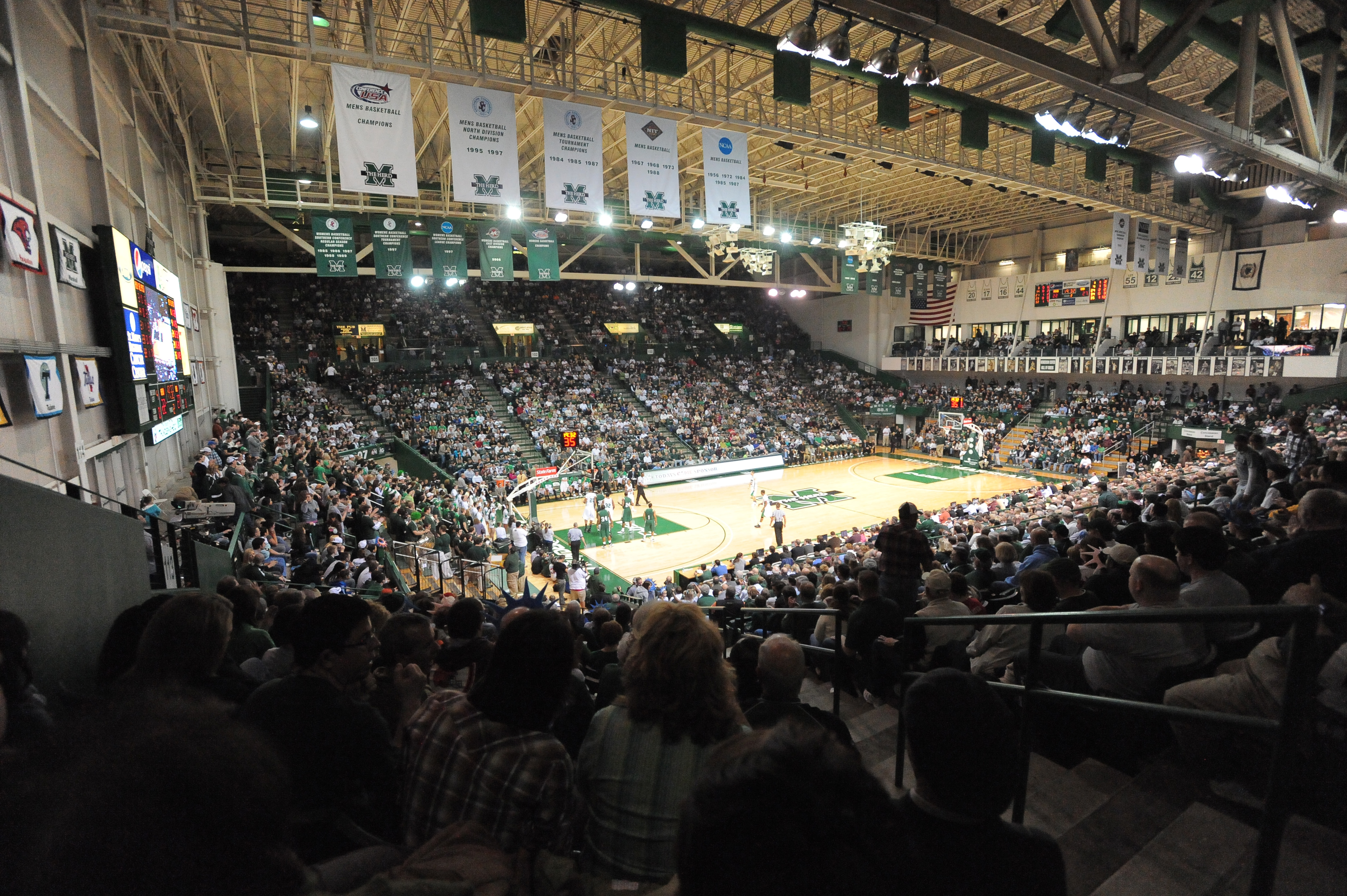The basketball arena can hold a little over 9,000 people.