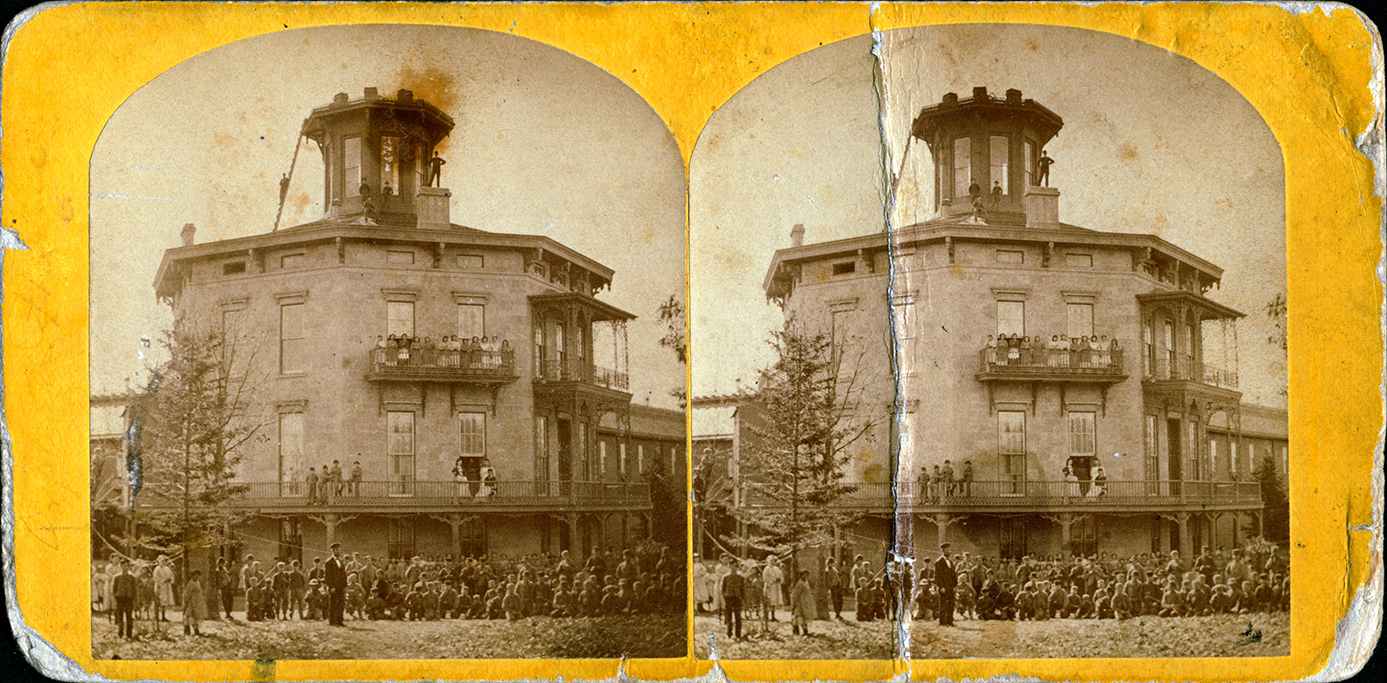 Stereoview of Harvey Hospital Soldiers and Orphans Home. Gathered in front of the Home are children posing in front of the Home.