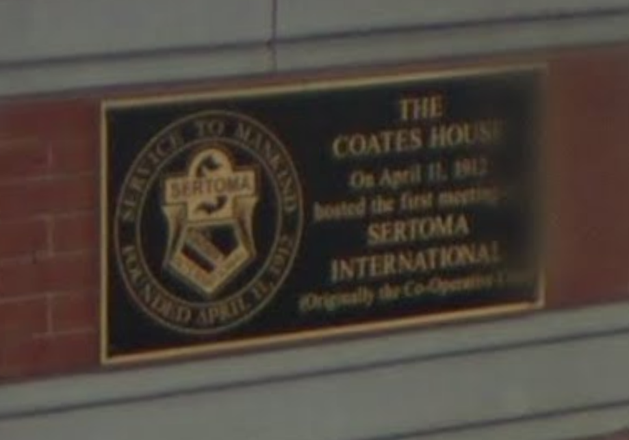 A picture of the Sertoma plaque in front of the hotel located on the corner of 10th and Broadway.