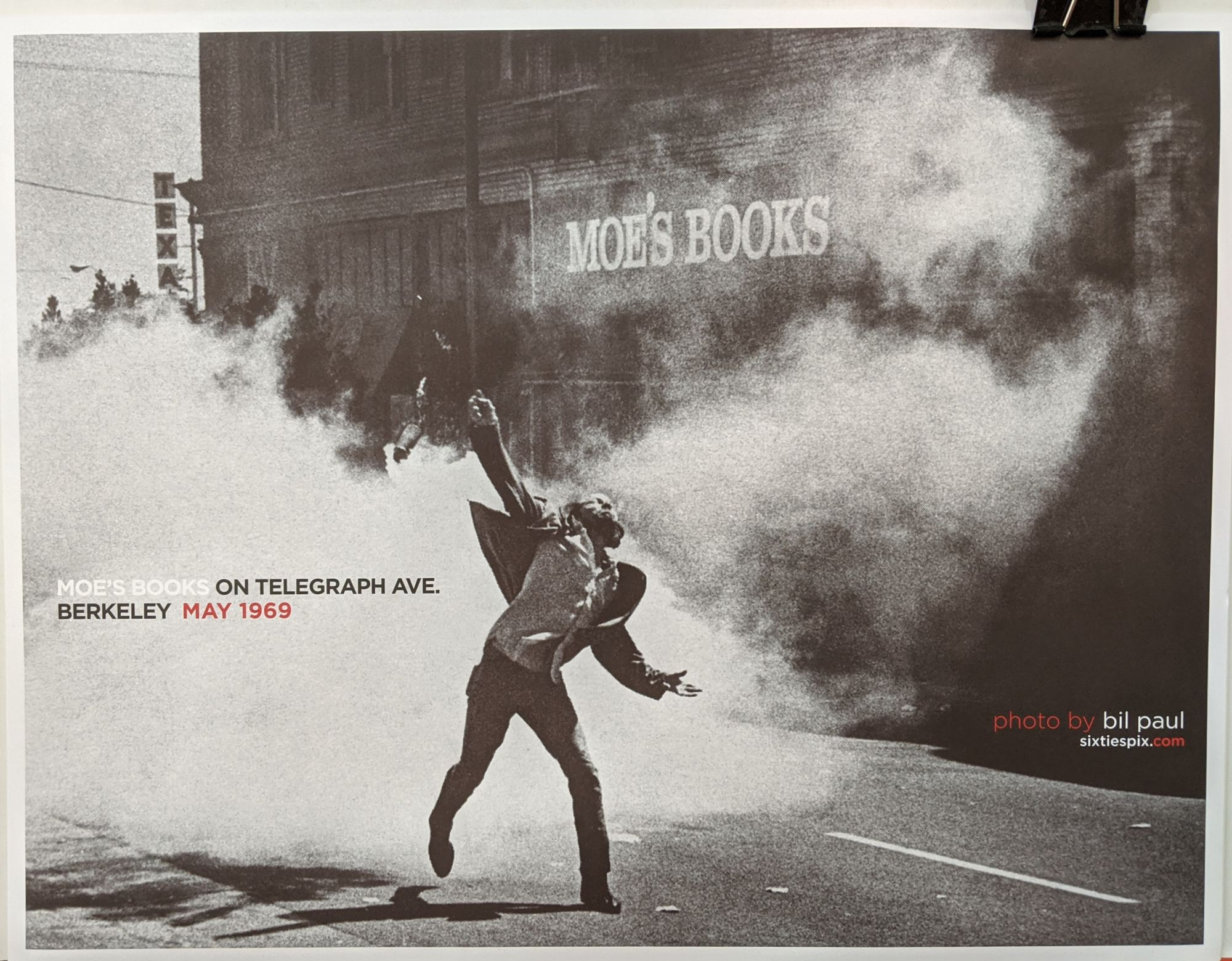 Photograph of protestor on Telegraph Ave during the People's Park protests (May 1969), showing Moe's Books in the background. This image was also made into a poster, which is sold at Moe's Books.