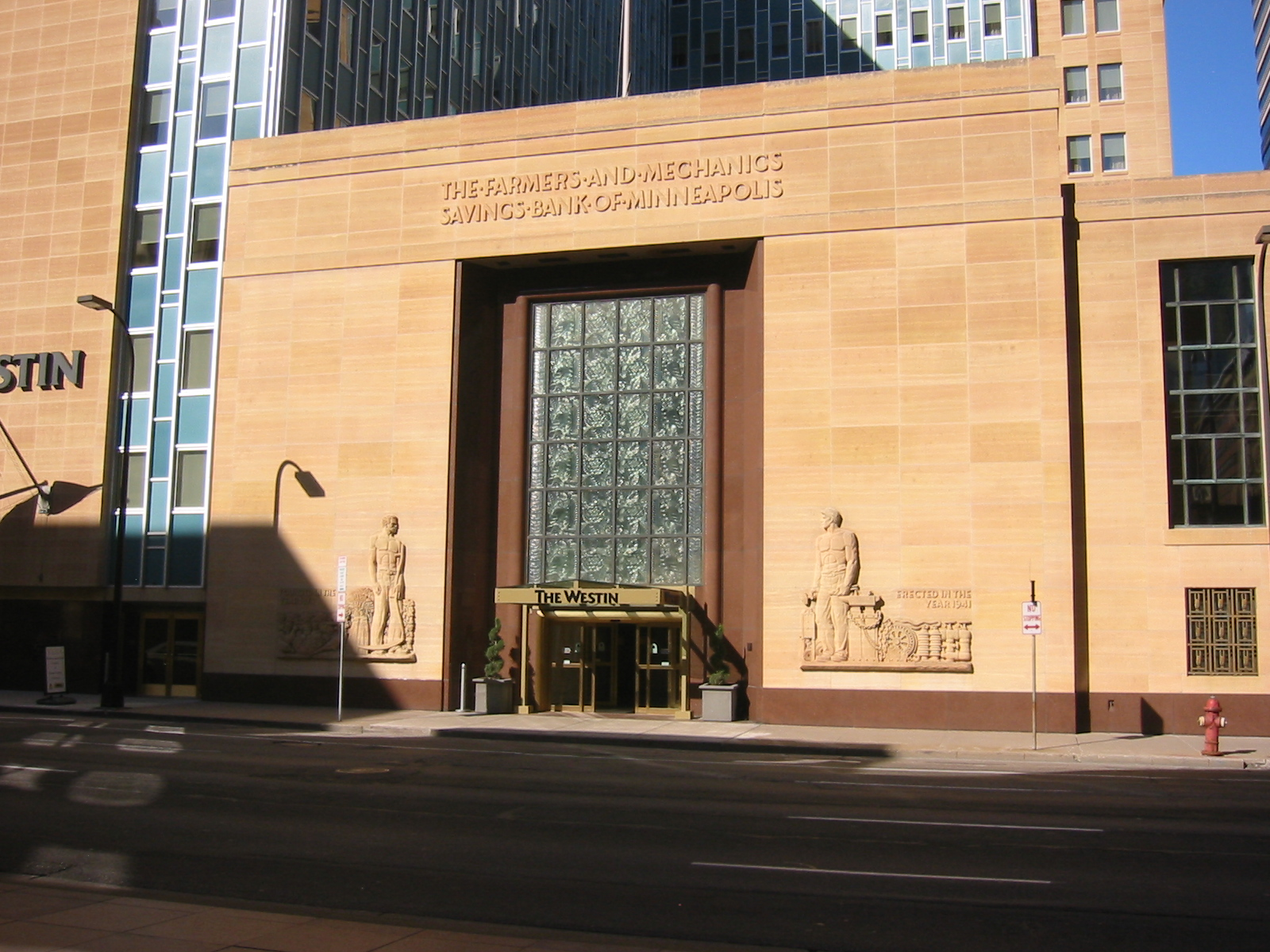 The F&M entrance, now the Westin Hotel entrance, includes carvings depicting farmers and workers.